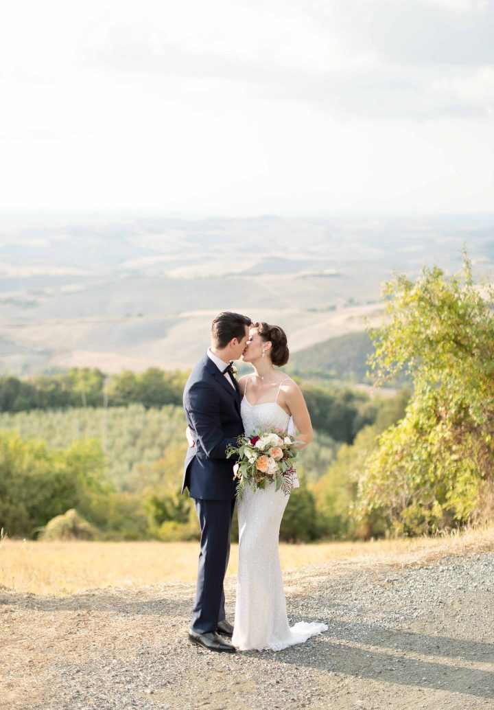 the kiss with the hills near volterrra in the background