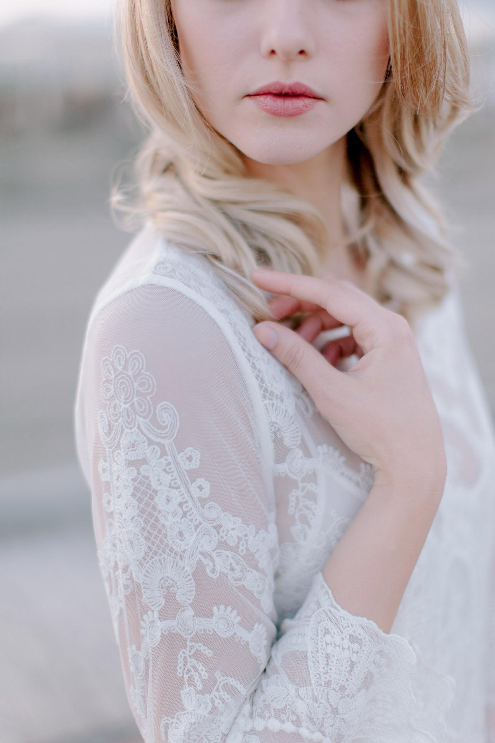 bride touching her shoulder